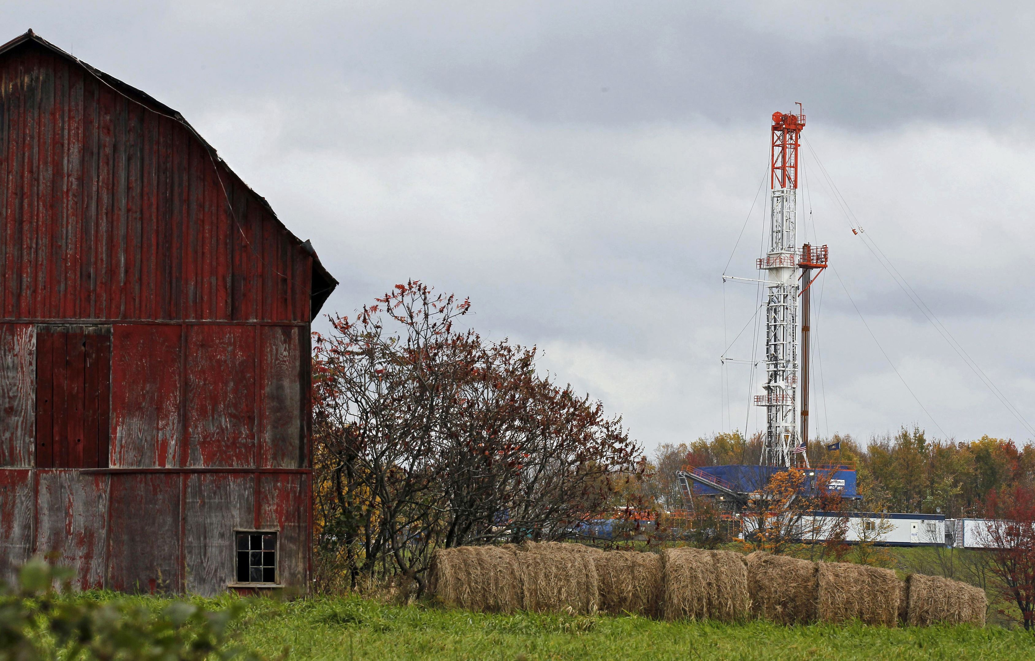 Gas Drilling Signs of Life-1 In this Oct. 14, 2011, file photo, a drilling rig is set up to tap gas from the Marcellus Shale gas field, near a barn in the Susquehanna County township of Springville, Pa.
