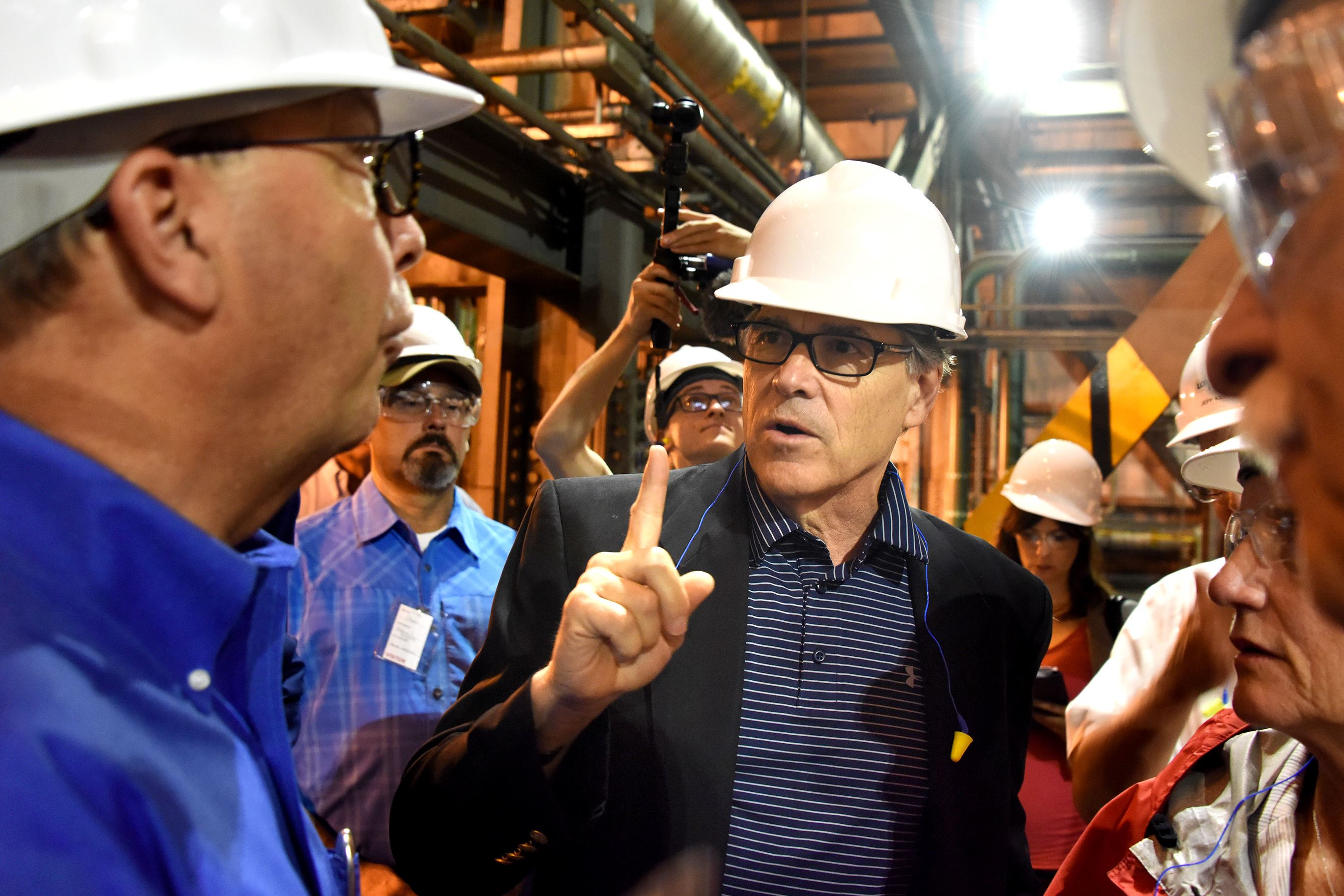 Sec. of Energy Rick Perry Energy Secretary Rick Perry talks with Steve Nelson, chief operating officer at the Longview Power Plant, as they tour the turbine building near Morgantown, West Virginia on Thursday.