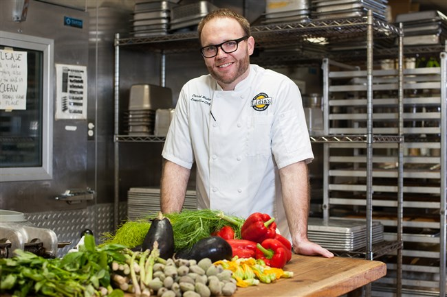 Daniel Walker, the new chef at Lidia's Pittsburgh, stands for a portrait in the restaurant's kitchen.
