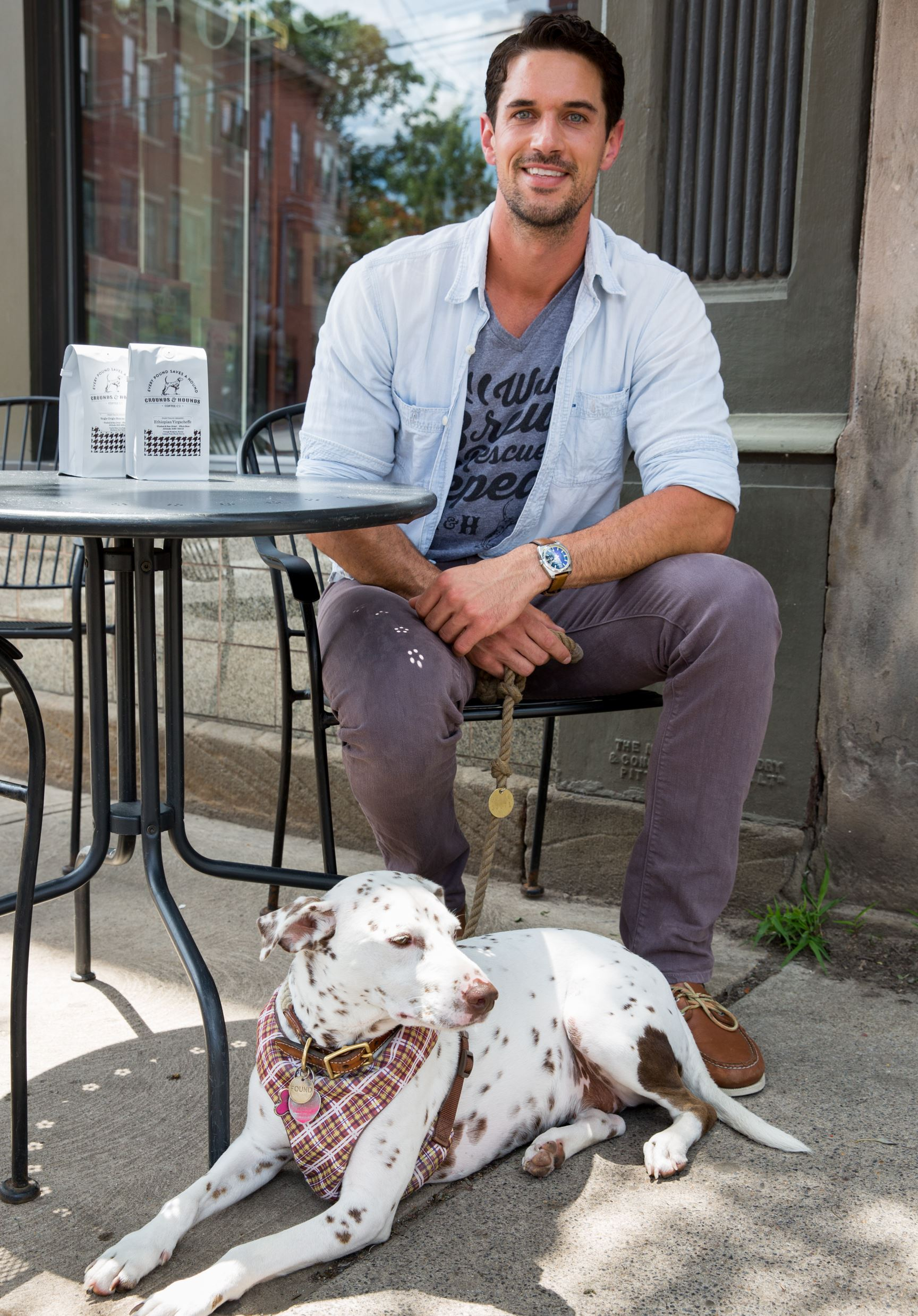 20170629adGrounds-Hounds-01 Jordan Karcher rescued Molly five years ago in California. Now she is the symbol and mascot of his Hounds & Grounds Coffee Co. in Lawrenceville.
