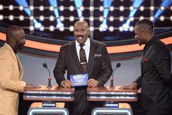 "Steelers running back Le'Veon Bell appears with host Steve Harvey, left, and Hall of Famer Marshall Faulk on an episode of ""Celebrity Family Feud"" Sunday on ABC."