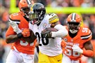 Steelers running back Le'Veon Bell fights off a defender during a Nov. 20, 2016, game at First Energy Stadium in Cleveland.