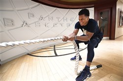 Shamiel Stevenson holds his ground during the tug of war conditioning workout in July.