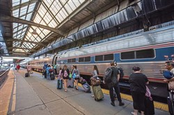 Passengers board the Pennsylvanian train at the Pittsburgh Amtrak station Downtown.
