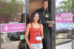 Former Steeler Wes Lyons, right, and his business partner and University of Pittsburgh graduate Amber Greene at their new business, Cakery Square, in The Waterfront shopping center in Homestead.