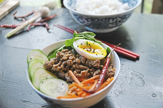 Garlic-Chili Pork Rice Bowl is a great platform for colorful vegetables and a six-minute egg.