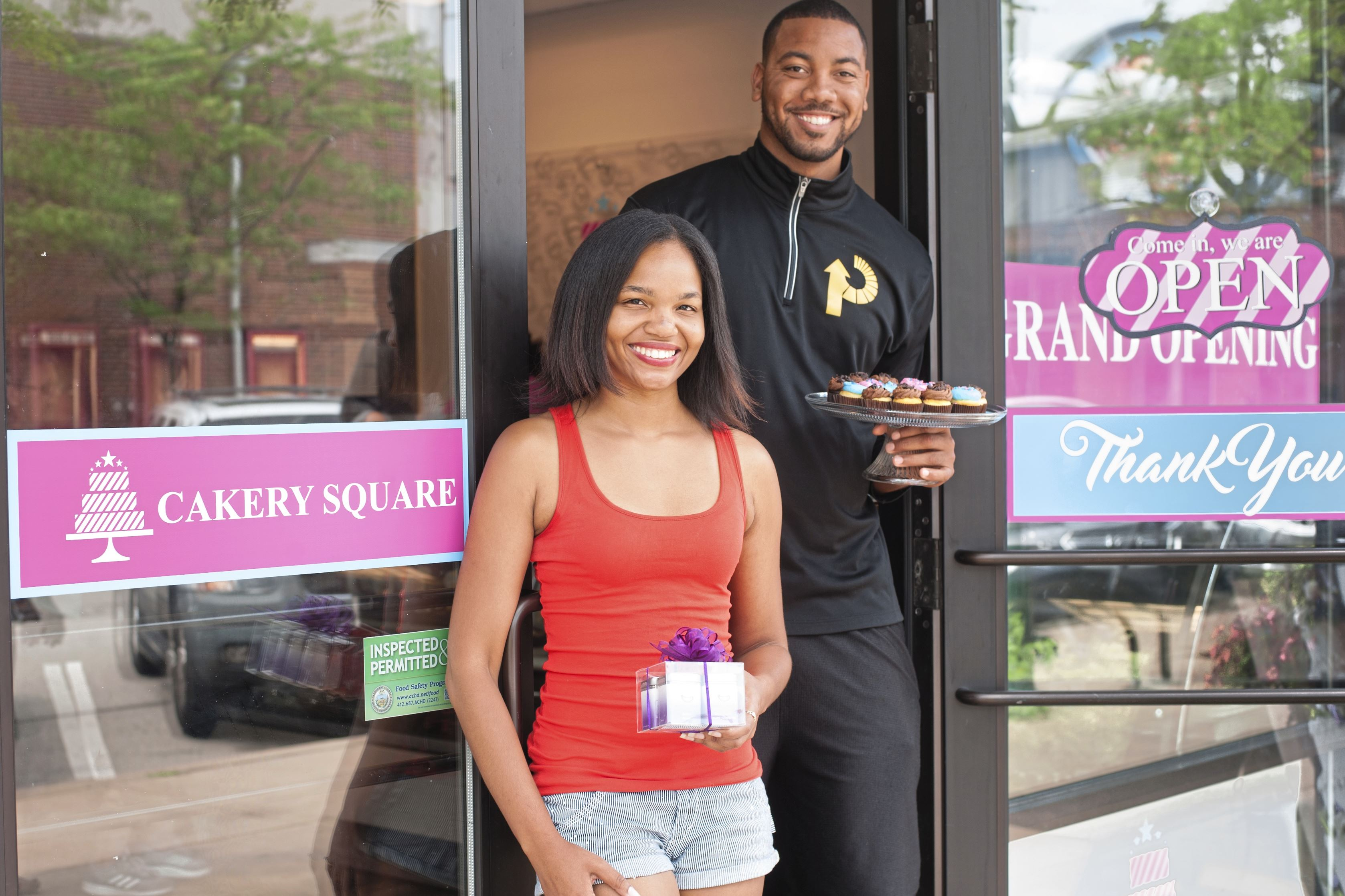 20170612smsCakery01 Former Steeler Wes Lyons, right, and his business partner and University of Pittsburgh graduate Amber Greene at their new business, Cakery Square, in The Waterfront shopping center in Homestead.