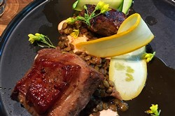 Entrées served at a soft opening Wednesday for Superior Motors in Braddock included lamb served with romesco, lentils and summer squash. It opens to the public on Saturday.