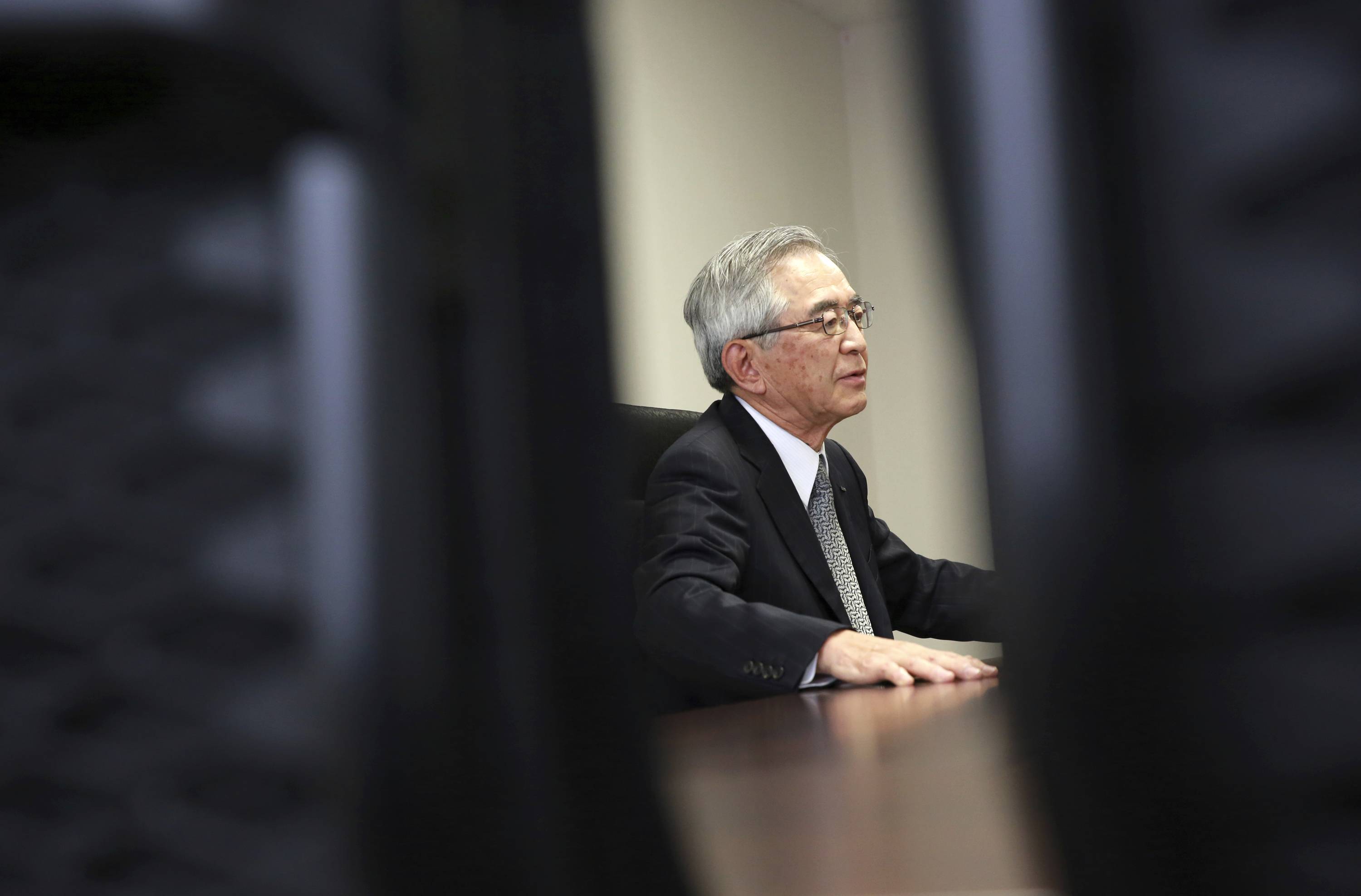 Japan Nuclear-1 Tokyo Electric Power Co.'s new Chairman Takashi Kawamura speaks during an interview at the TEPCO headquarters in Tokyo on Thursday, July 13, 2017. Kawamura said the utility needs to stop dragging its feet on plans to dump massive amounts of treated but contaminated water into the sea and make more money if it's ever going to succeed in cleaning up the mess left by meltdowns more than six years ago at the tsunami-hit Fukushima nuclear power plant. (AP Photo/Eugene Hoshiko)