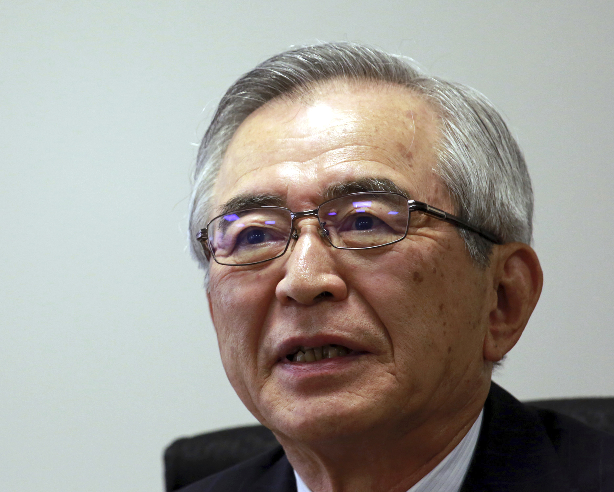 Japan Nuclear-4 Tokyo Electric Power Co.'s new Chairman Takashi Kawamura speaks during an interview at the TEPCO headquarters in Tokyo on Thursday, July 13, 2017. Kawamura said the utility needs to stop dragging its feet on plans to dump massive amounts of treated but contaminated water into the sea and make more money if it's ever going to succeed in cleaning up the mess left by meltdowns more than six years ago at the tsunami-hit Fukushima nuclear power plant. (AP Photo/Eugene Hoshiko)