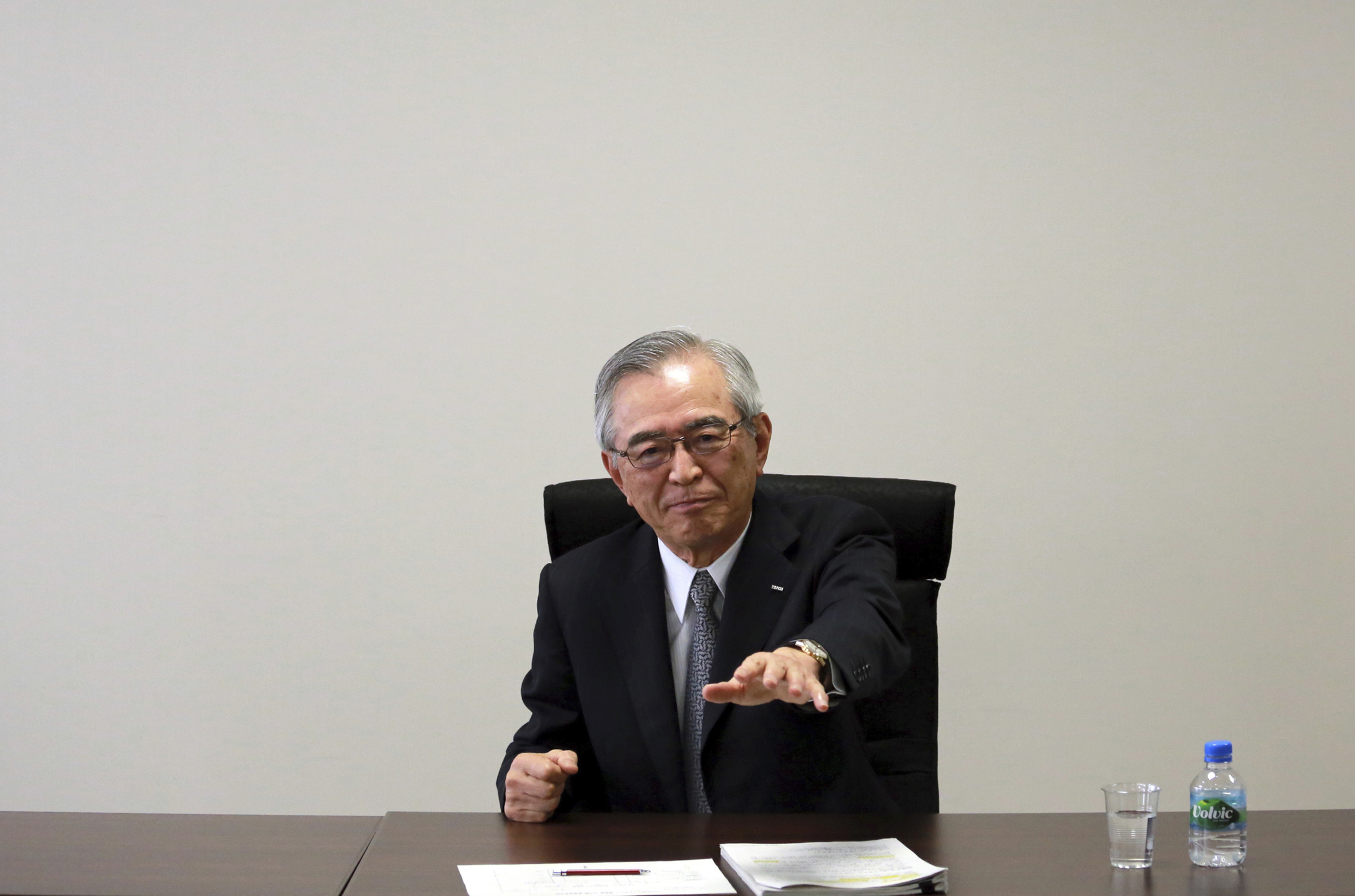 Japan Nuclear-5 Tokyo Electric Power Co.'s new Chairman Takashi Kawamura gestures while speaking during an interview at the TEPCO headquarters in Tokyo Thursday, July 13, 2017. Kawamura said the utility needs to stop dragging its feet on plans to dump massive amounts of treated but contaminated water into the sea and make more money if it's ever going to succeed in cleaning up the mess left by meltdowns more than six years ago at the tsunami-hit Fukushima nuclear power plant. (AP Photo/Eugene Hoshiko)