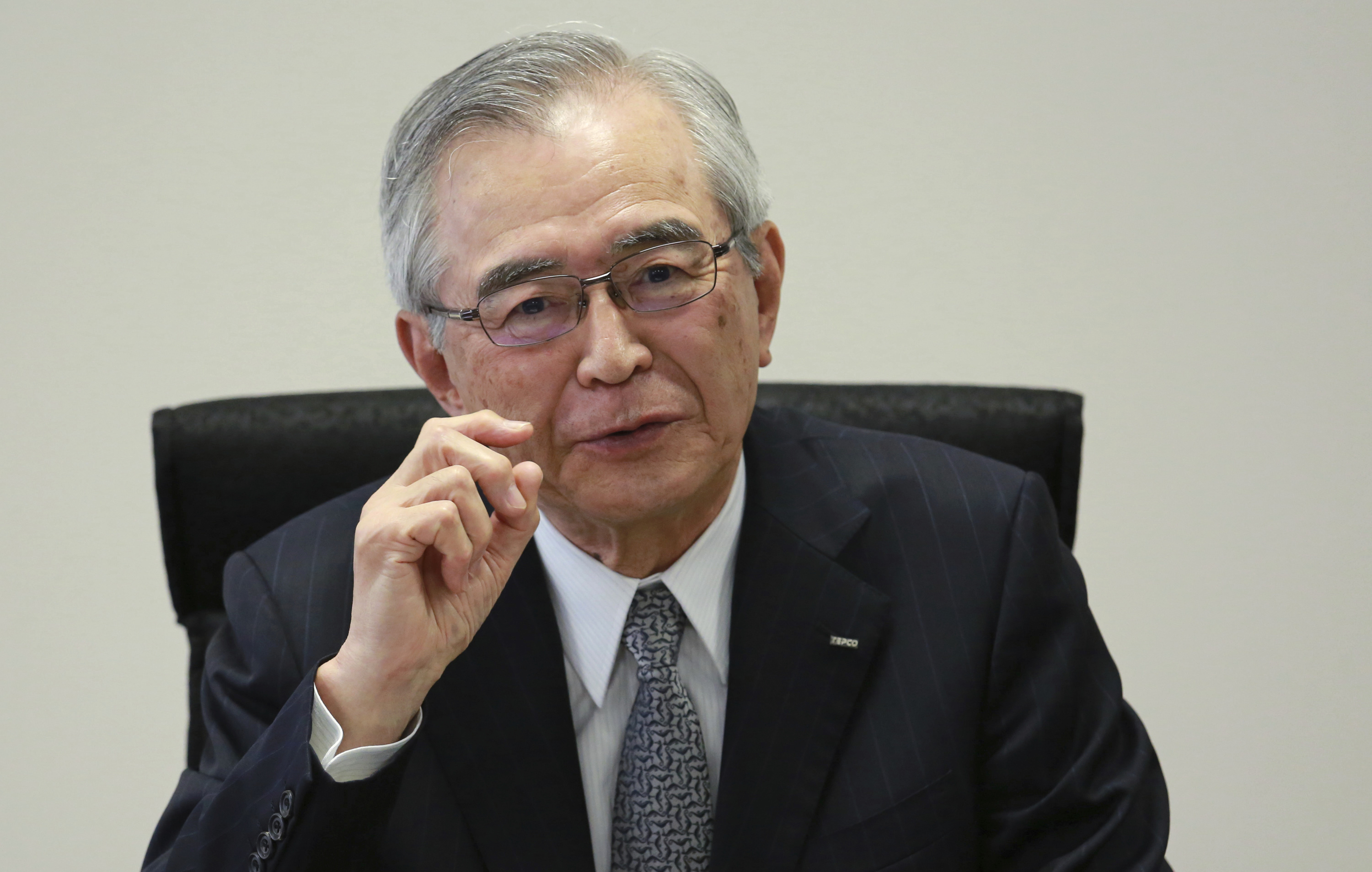 Japan Nuclear Tokyo Electric Power Co.'s new Chairman Takashi Kawamura speaks during an interview at the TEPCO headquarters in Tokyo on Thursday, July 13, 2017. Kawamura said the utility needs to stop dragging its feet on plans to dump massive amounts of treated but contaminated water into the sea and make more money if it's ever going to succeed in cleaning up the mess left by meltdowns more than six years ago at the tsunami-hit Fukushima nuclear power plant. (AP Photo/Eugene Hoshiko)