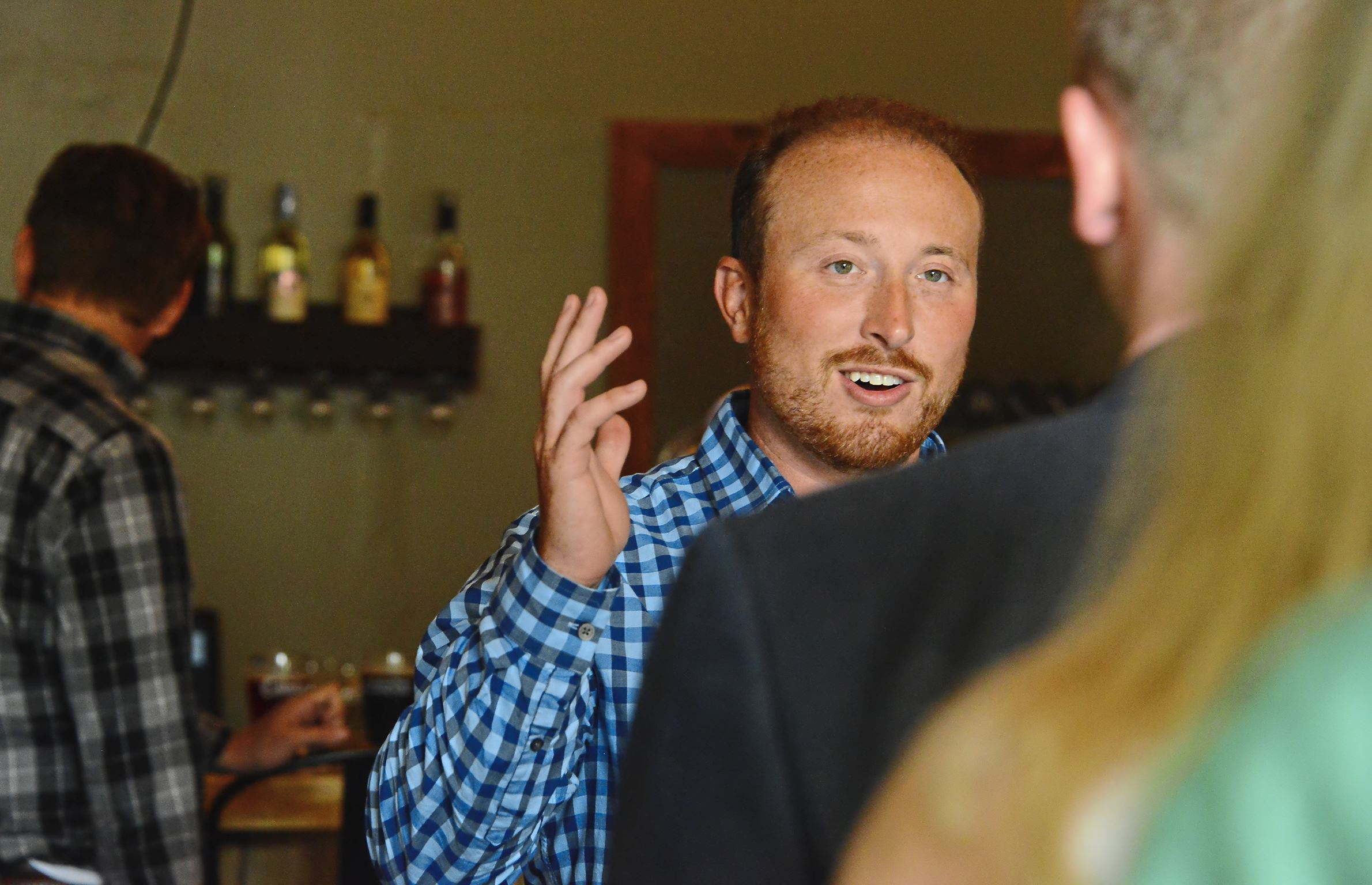 20170712lf-Job02-1 Zach Scott, right, greets Michael Krepsik and Ginger Randall in the Young Professionals in Energy gathering at Cobblehaus Brewing Company in Coraopolis. Zach Scott has been laid off from half a dozen oil and gas jobs. But he keeps coming back.