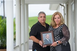 Michelle and Anthony Donatelli stand with a picture of Patrick McKallip, Michelle's son and Anthony's step-son who died from a heroin overdose in May 2016. The couple donated his heart, liver and kidneys to three different recipients.