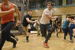 "The cast of Pittsburgh CLO's production of Disney's ""Newsies"" rehearses at the Benedum Center, where the show opens on Tuesday."