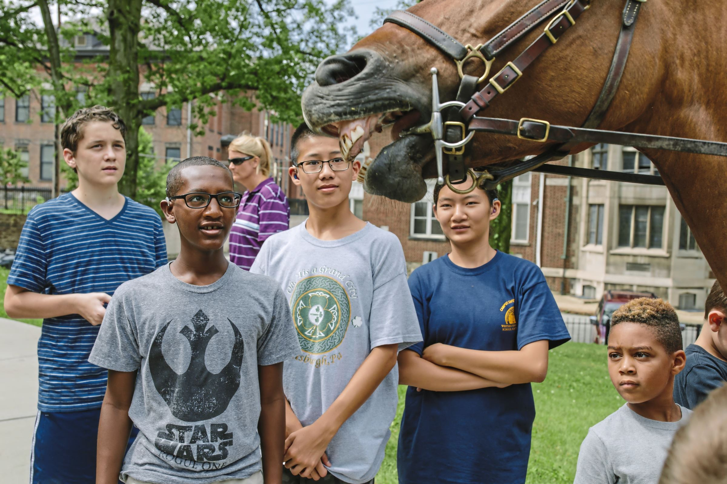 20170711arHorseAcademy01 Sam Adams, left, Gebreabzgi Helmstadter, Wade Dunbar, Bella Dunbar and David Hughes meet Milo, an Allegheny County Police horse, during the Western Pennsylvania School for the Deaf's Junior Police Academy in Edgewood. During the weeklong academy, law enforcement agencies make presentations to middle school students from WPSD and the surrounding communities.
