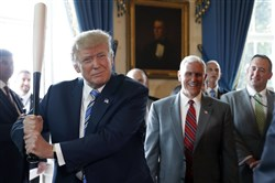 "President Donald Trump prepares to swing a Marucci bat, from Baton Rouge, La., with Vice President Mike Pence at right, during a ""Made in America"" product showcase featuring items created in each of the 50 U.S. states, at the White House on Monday in Washington."