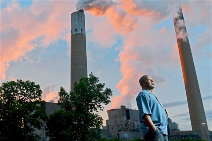 Herman Marshman stands outside the First Energy Bruce Mansfield coal fired power plant in Shippingport, Beaver County.