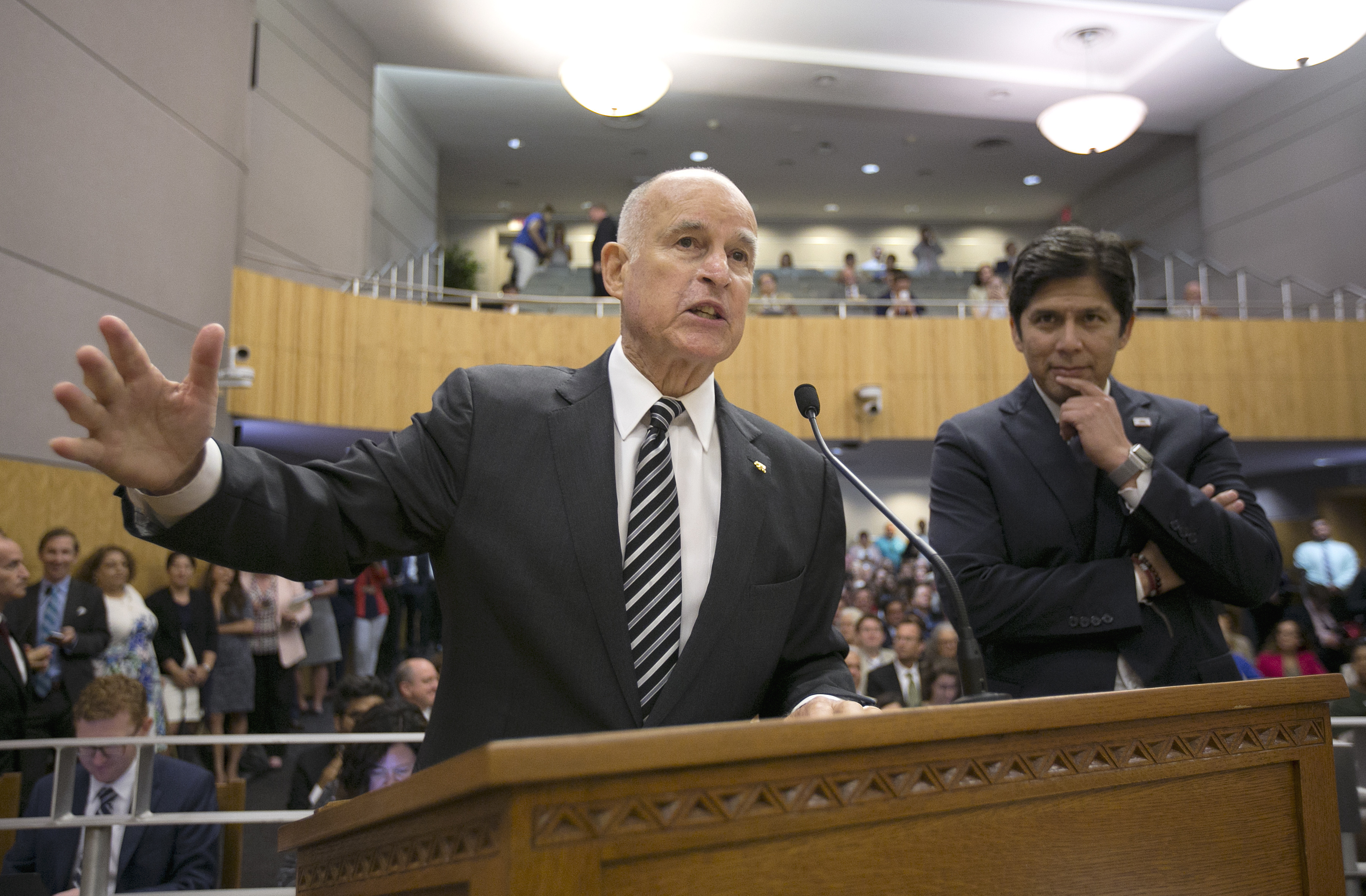 California Climate Change-2 FILE - In this July 13, 2017 file photo, Calif., Gov. Jerry Brown, left, testifies in support of a pair of climate change bills as Senate President Pro Yem Kevin de Leon, D-Los Angeles, looks on during a hearing of the Senate Environmental Quality Committee, in Sacramento, Calif. California lawmakers are nearing a high-stakes decision that will decide the fate of a climate initiative that Brown holds up as a model to be replicated around the world to confront rising global temperatures. A vote is set for Monday on whether to give another decade of life to California's cap-and-trade program. (AP Photo/Rich Pedroncelli,file)