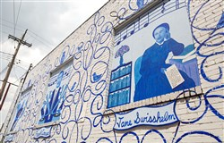 A mural created by artist Bob Ziller covers the rear of a building at 800 Penn Ave. that faces Stoner Way in Wilkinsburg. The artwork is part of efforts by the Center for Civic Arts to revitalize the borough.