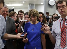 Sen. Lisa Murkowski,a Republican from Alaska, is followed by reporters as she walks through the Senate Subway inside of the U.S. Capitol on Tuesday.