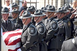 Trooper Michael Stewart's casket  arrives at the Holy Family Church in Latrobe on Tuesday morning. More than 1,000 police officers attended the services for the trooper, who was killed in a traffic accident.