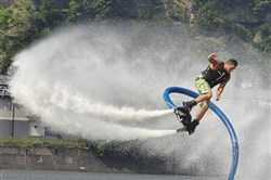 Gavin Melan of Belle Vernon shows his skill on a FlyDive. Melan was part of a a promotional event Wednesday on the North Shore leading up to the EQT Pittsburgh Three Rivers Regatta. The regatta will be held from Aug. 4-6.