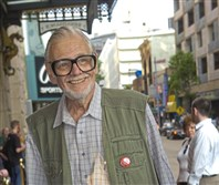 "George Romero walks down the red carpet into the Byham Theater in Downtown Pittsburgh in 2005 for the premiere of his movie, ""Land of the Dead."""