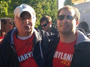 Phil Axelrod and his son, Joshua Axelrod, attend a University of Maryland football game during Josh's senior year of college in fall 2013.
