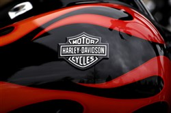In this April 27 file photo, the Harley-Davidson name is seen on the gas tank of a motorcycle in Northbrook, Ill.