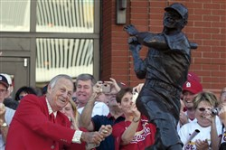 "St. Louis Cardinals great Stan ""The Man"" Musial strikes his signature pose after unveiling his statue at the re-dedication ceremony for the statues, at the new Busch Stadium in 2006."