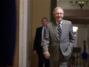 Senate Majority Leader Mitch McConnell of Kentucky walks into the Senate Chamber at the Capitol on Thursday in Washington.