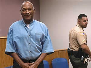 O.J. Simpson enters his parole hearing Thursday at the Lovelock Correctional Center in Lovelock, Nev. Simpson was convicted in 2008 of enlisting some men he barely knew, including two who had guns, to retrieve from two sports collectibles sellers some items that Simpson said were stolen from him a decade earlier.