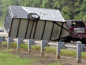 A man was killed after his SUV that was hauling a large trailer crashed along the Pennsylvania Turnpike westbound in New Sewickley, Beaver County Friday morning.