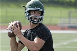 Pine-Richland quarterback Phil Jurkovec eyes a receiver during a 7 on 7 scrimmage against Hampton this summer.