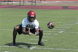 New Castle runing back Marcus Hooker catches a pass during a summer practice at Taggart Stadium in New Castle.