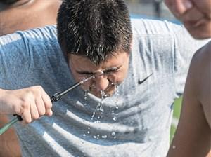 West Mifflin's Trevor Brownman cools off during practice at West Mifflin High School.