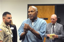 O.J. Simpson reacts after learning he was granted parole at Lovelock Correctional Center on Thursday in Lovelock, Nev.