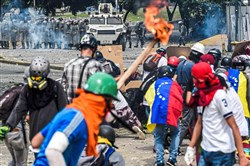 Opposition activists clash with riot police Sunday during a march toward the Supreme Court of Justice in an offensive against Venezuelan President Nicolas Maduro and his call for constituent assembly in the capital, Caracas.