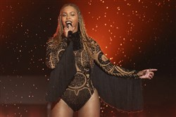 "In this June 26, 2016, file photo, Beyonce performs ""Freedom"" at the BET Awards in Los Angeles. A wax figure of Beyonce at Madame Tussauds in New York has been given a makeover after fans of the megastar said the figure was too white."