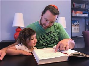 Chris Hall, the head of adult education at Beth Shalom, studies with his daughter Ada. Since he converted to Judaism at a conservative synagogue as an adult, his religious practice is central to his life.
