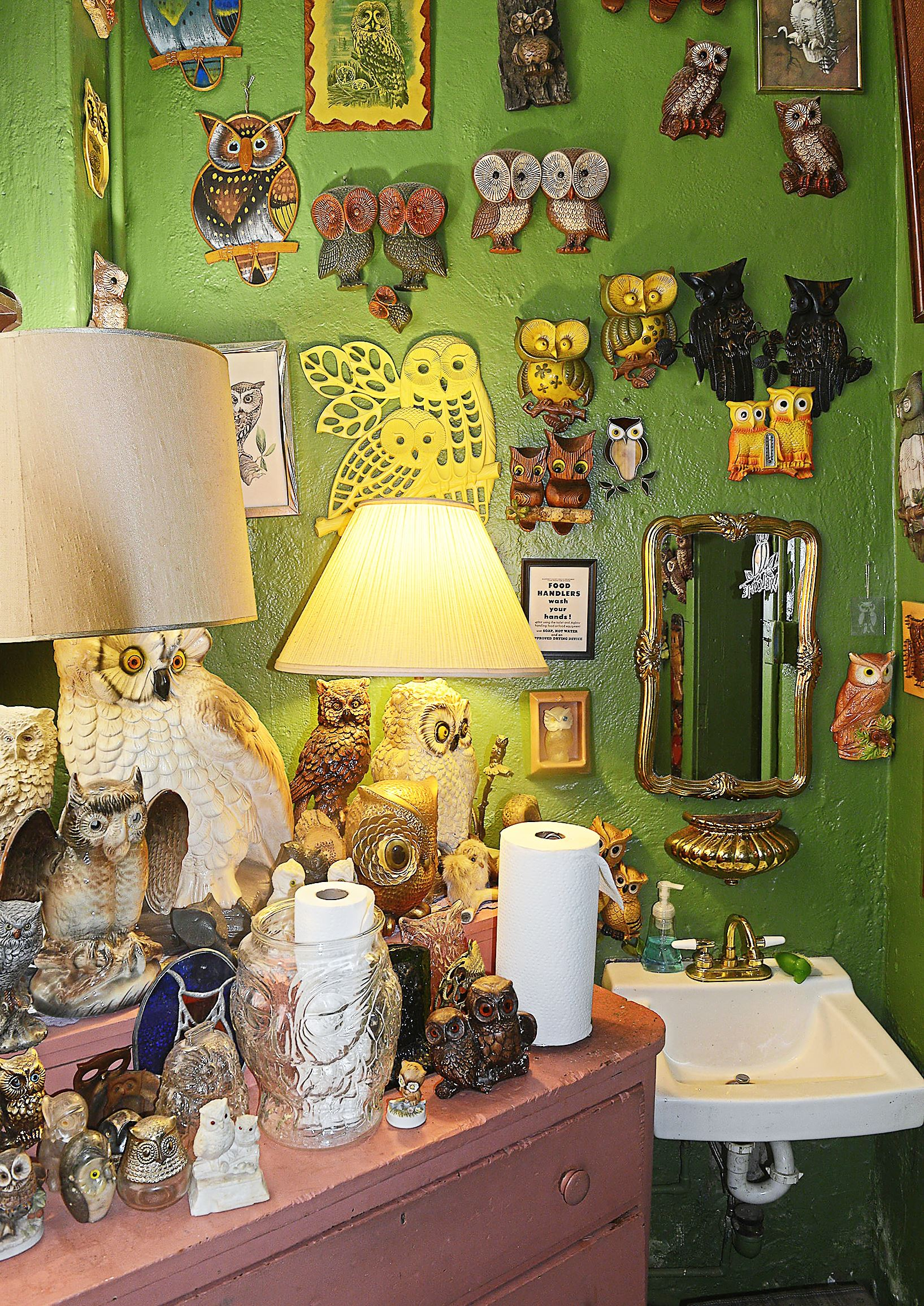 20170723lrfoodzenith11-10 The Zenith, part restaurant and part antique shop, located on the South Side at the corner of Sarah and 26th, adorns the restroom with a collection of owls -- not for sale.