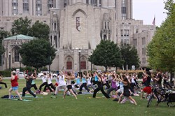 Fitness seekers get their yoga on in Schenley Plaza, Oakland.