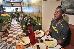 Steelers rookie wide receiver JuJu Smith-Schuster shares a laugh over breakfast at Deluca's Diner in the Strip District.