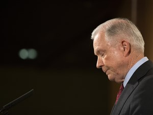 """Attorney General Jeff Sessions gives a statement Thursday saying that he will continue to serve """"as long as that is appropriate,"""" following comments from President Donald Trump, at the Department of Justice in Washington."""