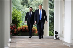 President Donald Trump and Lebanese Prime Minister Saad Hariri walk into the Rose Garden for a joint news conference at the White House on Tuesday in Washington.