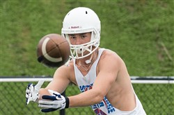 Trinity wide receiver Tanner Hudak focuses on catching a pass during a summer practice at Trinity Middle School on July 25, 2017.