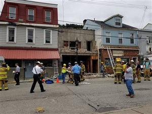 The brick facade collapsed from a building near Grant Avenue and Sherman Street in Millvale.