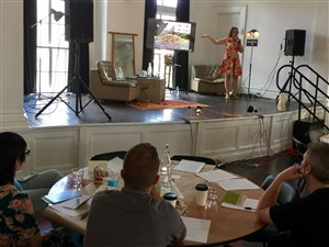 Jennifer England of 412 Food Rescue addresses attendees of the 86 Conference at the ace hotel in East Liberty, on the topic of food waste and solutions for it.