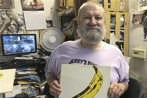 "Jerry Weber of Jerry's Records with a rare peelable banana copy of ""Velvet Underground & Nico."""